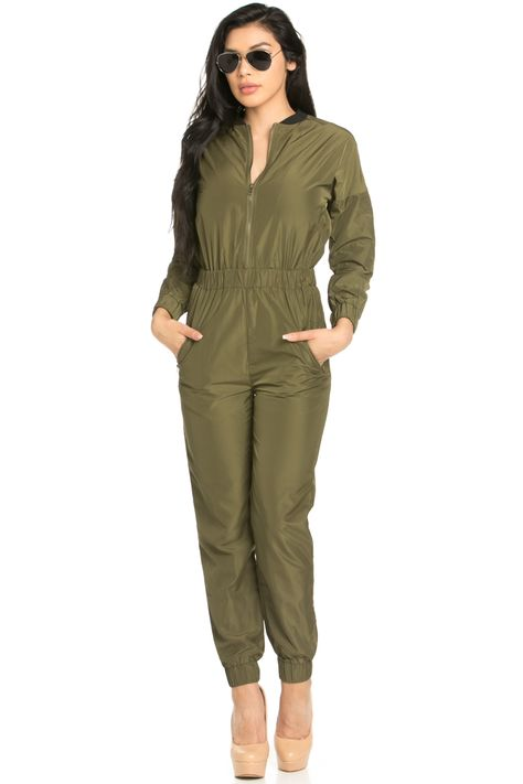 The effortless long sleeved, woven olive bomber jumpsuit with an exposed zip front. Features zip pockets on both hips, elastic cinched waist band, and elastic cinched wrist and ankle cuffs.    Fabric100% Polyester; Contrast: 100% Polyester    Made In Imported    Care      Machine wash cold water with like colors  Gentle Cycle  Dry Flat      Yuccie Babe ❤      Height5'10