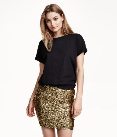 61b7bff28f03b0 Gold sequined skirt in jersey with an elasticized waistband.