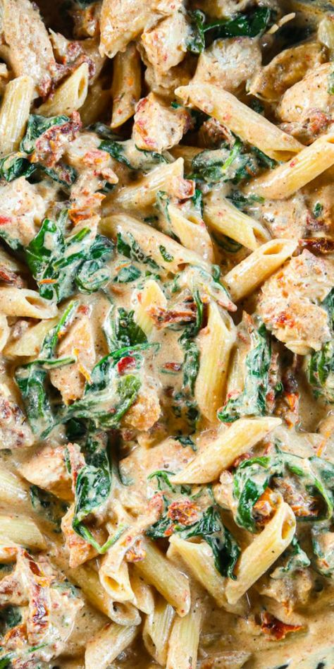 This Creamy Tuscan Chicken Pasta is so deliciously flavored. Garlicky and cheesy its easy to make and takes only 30 minutes. Tuscan Chicken Pasta, Chicken Pasta Dishes, Cheesy Chicken Pasta, Creamy Pasta Dishes, Italian Pasta Dishes, Healthy Chicken Pasta, Creamy Chicken, Alfredo Chicken Pasta, Pasta Recipes With Chicken