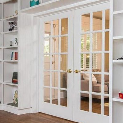 Swinging French Doors With Glass Panels Separating A Library From A Living Room In 2020 French Doors Bedroom Glass Doors Interior Installing French Doors