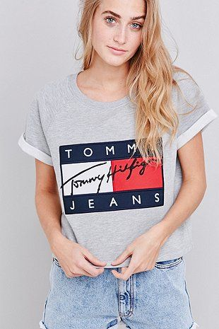 fdf2bcca216b4 Re-issued logo t-shirt made exclusively for UO by Tommy Jeans because the   90s are forever. In a super soft knit with a boxy silhouette cut wide wi…
