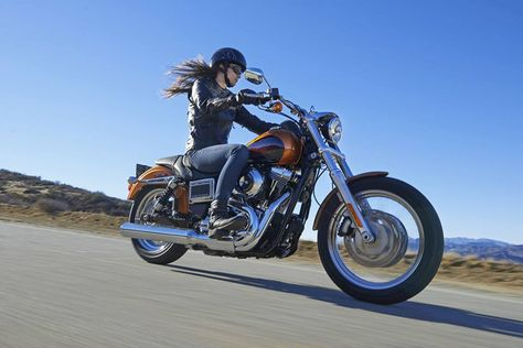 biker babe hiting the rode , how dose she feel , she knows