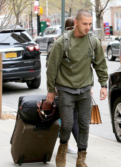Shia LaBeouf with his eyebrowless girlfriend in NYC