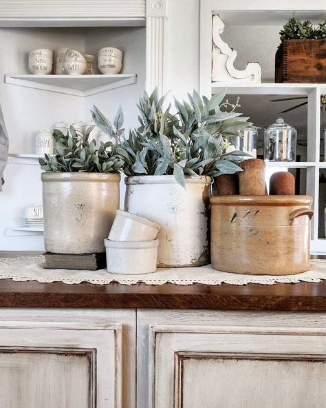 IT'S ALL A CROCK! Well it is in my kitchen anyway.😅 I've decided to do an early Spring refresh and I went old school in my… Antique Crocks, Old Crocks, Antique Stoneware, Stoneware Crocks, Antique Farmhouse, Farmhouse Kitchen Decor, Farmhouse Style, Farmhouse Lighting, French Farmhouse