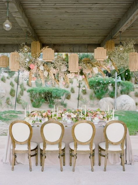 This refined and femme Cabo wedding inspiration will leave your heart a flutter in no time! With an off-the-shoulder wedding dress, ethereal bridal headpiece, hanging tablescape pendants, handpainted dinnerware and sunset colored blooms, we have a feeling this unique beach wedding inspiration is one that will stick for years to come. #destinationwedding #beachbride #intimatewedding