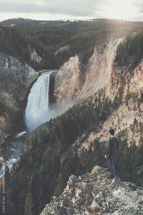 Man standing at Yellowstone Falls by LukeGram | Stocksy United