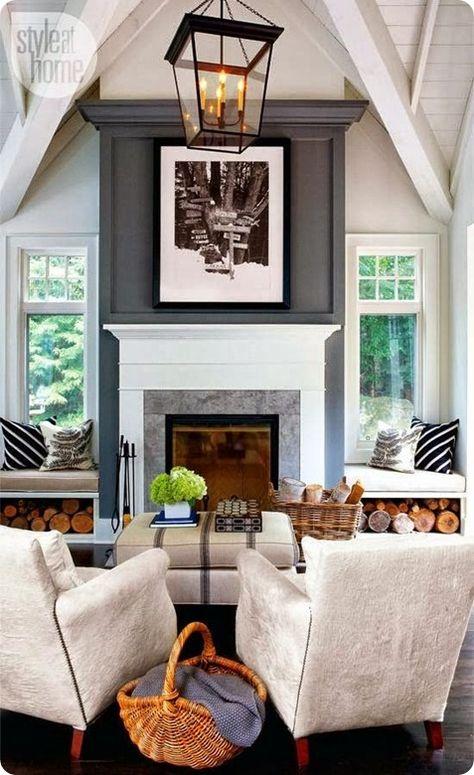 Amazing fireplace between windows. Great lantern light fixture too!