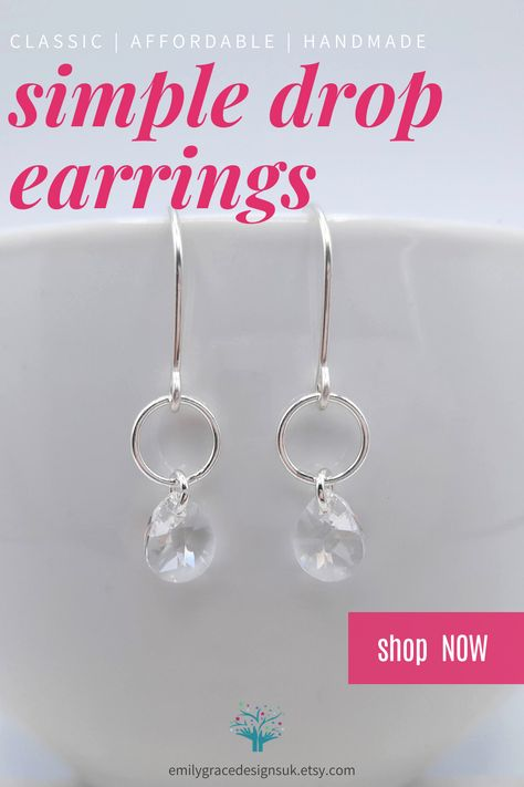 Beautiful handmade sterling silver geometric open circle drop earrings with delicate Swarovski Pear Teardrop Crystal. They are simple and elegant, making them easy to wear both day to day, or to add that bit of sparkle to a night out. A perfect gift for any occasion, or to treat yourself! With FREE UK delivery shop now at Emily Grace Designs. #crystalearrings #handmadeearrings