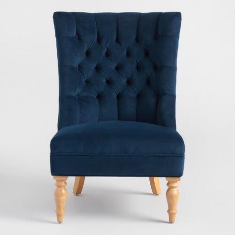 Sink into maximum comfort with our plush accent chair featuring a high back and wide seat that cups the body. Covered in soft ink blue velvet-like upholstery, it's crafted of hardwood and detailed with tufted accents for a classic look.