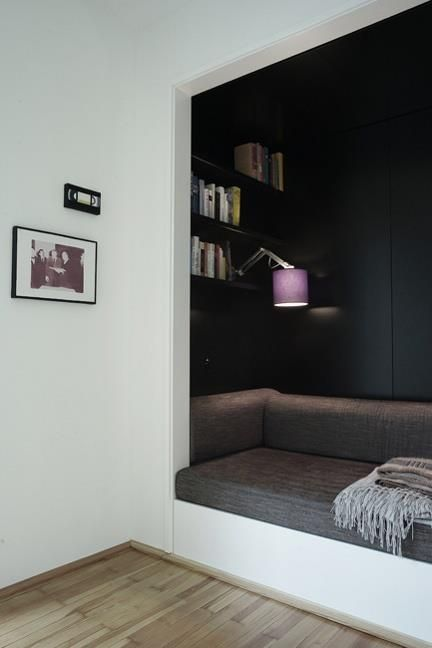In a very small room, turn a closet into a reading nook! (Build storage under  the seating area)