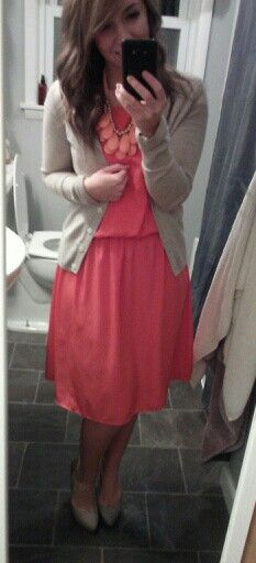 Coral dress, oatmeal colored cardigan and a light coral statement necklace