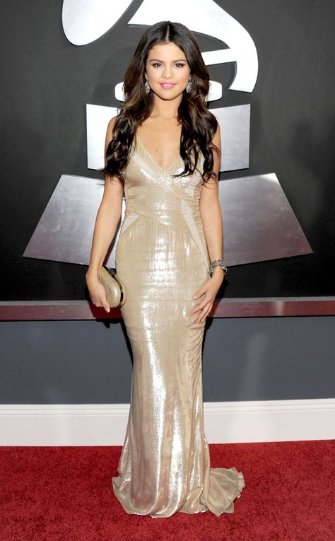 Selena Gomez from Best Dressed Stars Ever at the Grammy Awards  The young star shimmered in a metallic J. Mendel gown that lent her a gorgeous glow at the 2011 Grammy Awards.