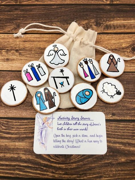 Let your child tell the story of Christ's birth in his/her own words!  This set of hand-painted wooden discs are a fun, tactile way to  learn and talk about the birth of Jesus. #nativitystorystones #storystarters #storyrocks #Christmasstorystones #storystarters #birthofJesus #Mangerscene