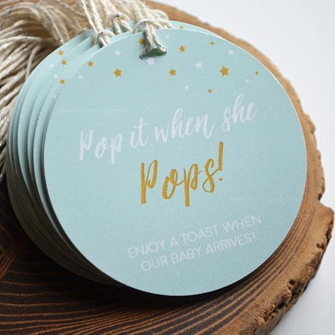 Tied around mini bottles of champagne, these baby shower favors are all the buzz! . Or, you could go the non-alcohol route and tie around freshly popped bags of caramel corn, sweet! Either way, these are going to be a hit! This listing is for fully assembled POP GIFT TAGS. Tags read, Pop