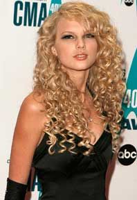 girls with loose permed, spiral hair, with layers   Taylor shows off a