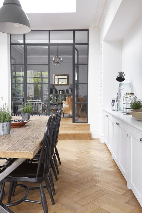 Blakes - Crittall screen (grey) & Windsor chairs on black