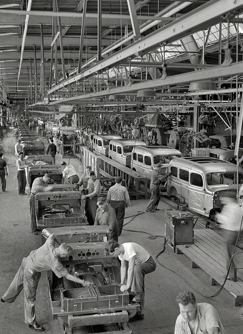 August 1942. Chrysler Corporation Dodge truck plant. Hundreds of deft operations are required to assemble and finish the long lines of Dodge Army truck bodies that move daily to final production lines.