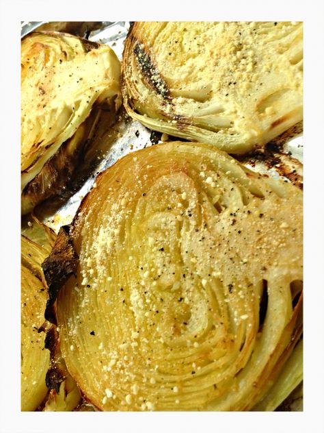 roasted cabbage steaks  1 Head Raw Green Cabbage About 6 Tbsp Butter (You could use Olive Oil too, I'm just weirded out about heating olive oil because of some studies I have heard!  I don't mind a little fat in the butter, but it's up to you!!) 2-3 tsp Garlic Powder, depending on your love level Sea Salt and Pepper to taste Tbsp Powdered Parmesan (Optional)