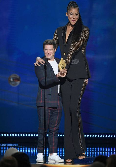 Towering WNBA player Candace Parker presents with tiny actor Adam DeVine at 2018 NBA Awards show