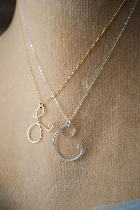 """I LOVE this initial necklace!! There are a number of the initials that are super pretty like the """"L"""" & """"A"""". Also made in Rose Gold. Say my Name Initial by makepienotwar on Etsy - $39"""