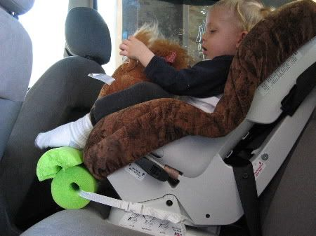 Someone told me about this idea.  Using a pool noodle for a footrest for the kiddos.  This will be perfect for travel.