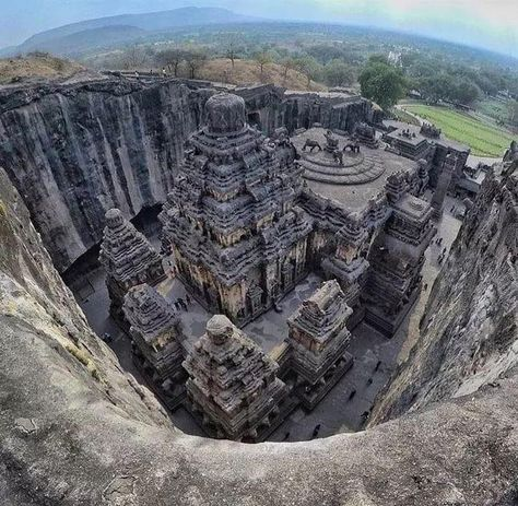 The Kailasa temple was carved out of one single rock. Also known as 'Cave of the Ellora Caves, it is notable for being the largest monolithic structure in the world carved out of a single piece of rock. The Kailasa temple was carved out of one s Indian Temple Architecture, India Architecture, Ancient Architecture, Amazing Architecture, Temple India, Hindu Temple, India Travel Guide, Travel Europe, Amazing India