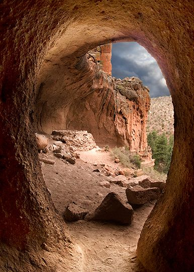 Kiva Bandelier National Monument, New Mexico.  Check out those ominous (but awesome) clouds in the background.