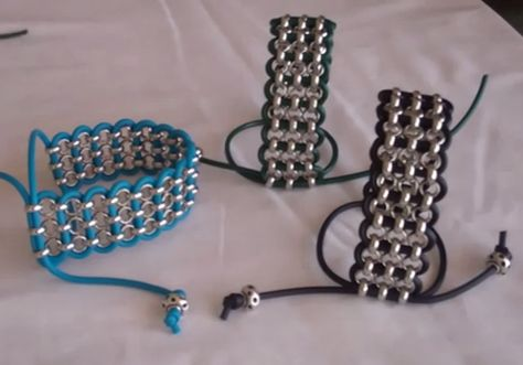 3 rows of rolo chain with cord crossing through to connect all three chains