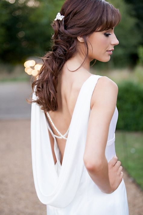 Cross-back beads and low drape back wedding gown