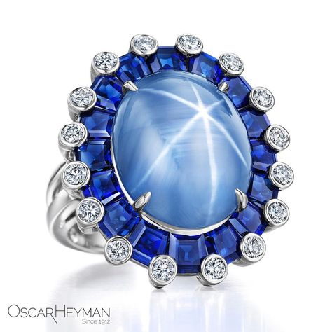 Oscar Heyman S Extraordinary Platinum Ring With A Stunning 14 53cts Star Sapphire Accented With Blue Sapphires 5 89cts And Diamonds 0 73cts