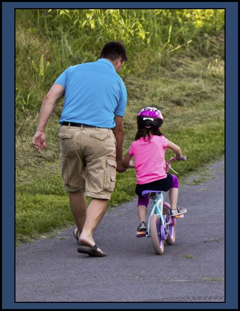 35b50f68ea031 LBT 14 Dad teaching daughter to ride a bike