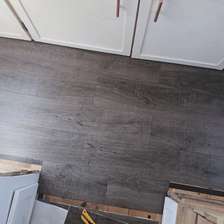 We Started Putting In Our Flooring Yesterday So Exciting We Debated For A While About Whether We Should Go Brown Laminate Flooring Flooring Dark Floors