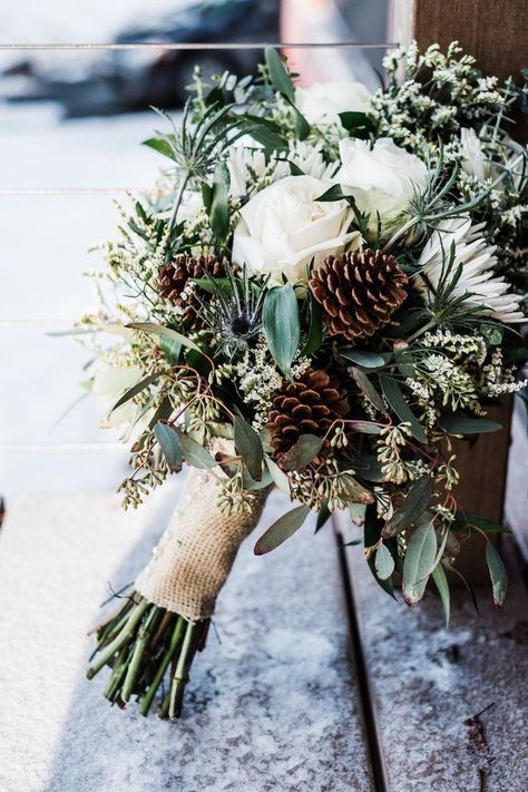 rustic winter wedding bouquet with white roses, eucalyptus and pine cones The post 20 Chic Wedding Bouquets Ideas for Winter Brides appeared first on Woman Casual - Wedding Gown Pinecone Wedding Decorations, Christmas Wedding Bouquets, Winter Wedding Centerpieces, Winter Wedding Flowers, Rustic Wedding Bouquets, Wedding Arrangements, Winter Wedding Cakes, Winter Wedding Ideas, Vintage Christmas Wedding