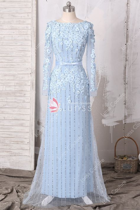 710f2c28bd66 This fancy light blue tulle formal gown features lined beads and sequin  through the whole dress, with petals flowers adorned on illusion long  sleeve bodice ...