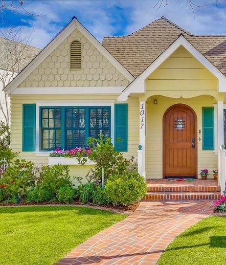Charming Yellow Beach Cottage With Wood Door In Coronado California Beach Cottage Exterior Yellow House Exterior House Designs Exterior