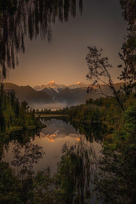 Natures Window Sunrise on the west coast of New Zealand at Lake Matheson