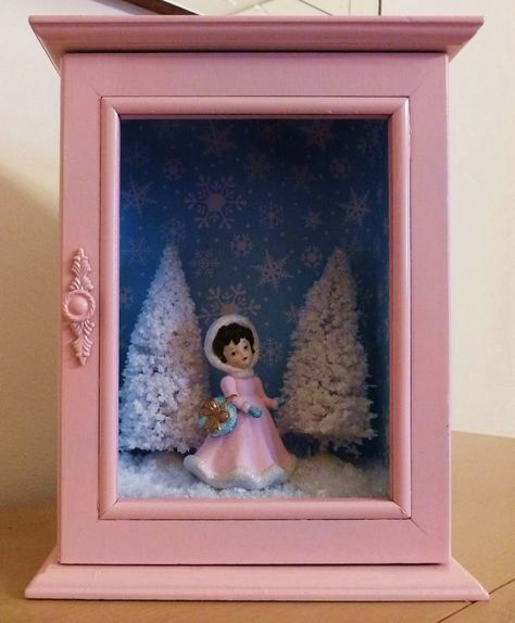 Holiday shadow box made from vintage figurine and old painted jewelry box. Led lights could be added inside. :)