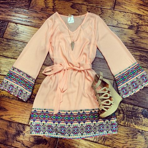 I would trade the shoes out for a dark brown wedge instead but the dress is stunning. Bohemian vibe with a chic twist.