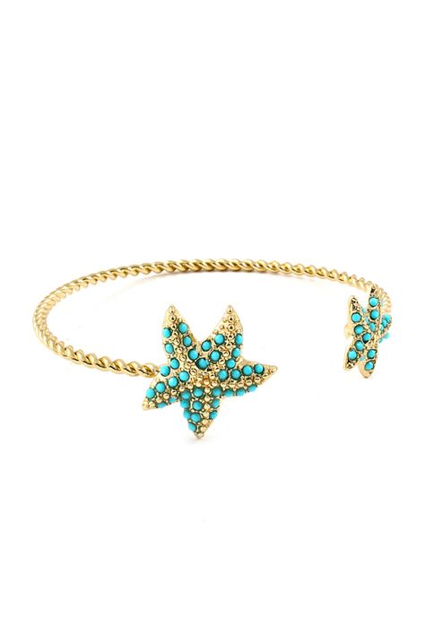 Golden Starfish Cuff Bracelet finished with tiny turquoise beads.