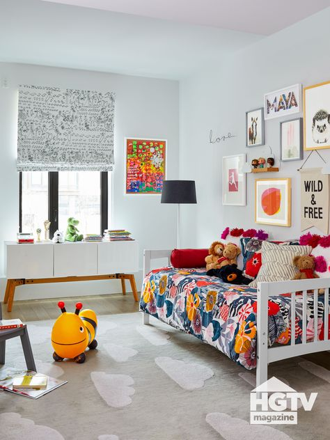 A colorful gallery wall, floral begging and modern accents make a girl's bedroom pop. See more on HGTV.com.