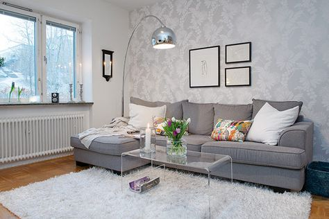 Affordable Grey Spacious Living Room In Small Apartment With Silver Arch Lamp And White Rug Areas