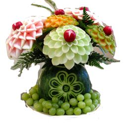 Fruit carved center piece for buffet table