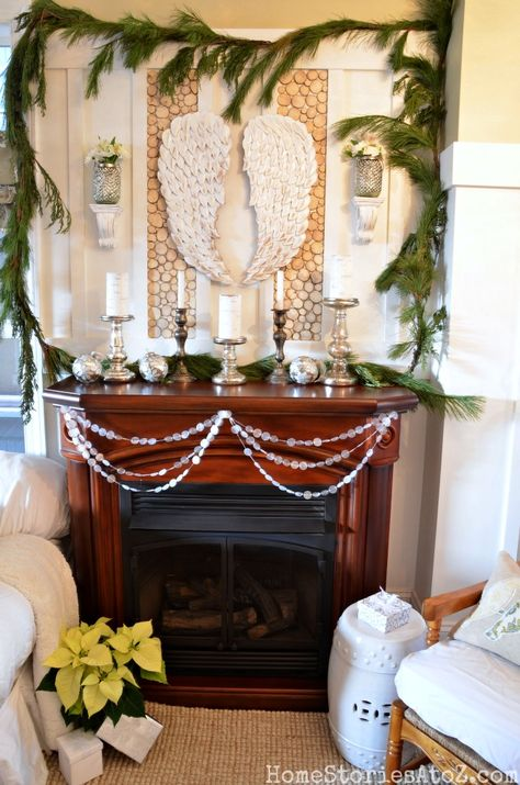 Christmas mantle idea with DIY wood round wall and DIY wax paper garland.