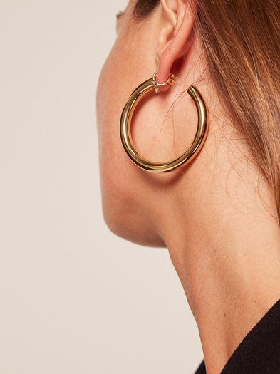 Just some little somethings. Pair of oversized lightweight Gold Plated Stainless Steel Hollow hoops. Bagatiba logo engraved on inside of hoop end.