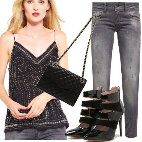 Look molto femminile adatto sia al giorno che alla sera, per le tue uscite in stile rock chic. Te lo descrivo: top con spalline sottili decorato con borchie, jeans skinny, stivaletti in vernice e tracolla trapuntata.