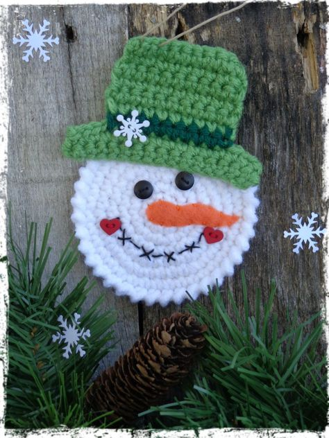 Who wouldnt love this adorable little snowman? Tie this sweet little man on a package for family and friends. Every year they will hang it on their Christmas tree and remember you! Snowman was crocheted with white yarn and a green top hat. His hand-stitched face is embellished with