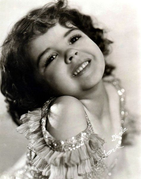 Darla Jean Hood (November 4, 1931 - June 13, 1979) was an American child actress, best known as the leading lady in the Our Gang series from 1935 to 1941. She was born in Leedey, Oklahoma, the only child of James Claude Hood and Elizabeth Davner. Her father worked in a bank and her mother was a music teacher.