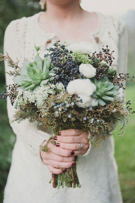 Woodsy wedding bouquet with succulents, berries, and raw cotton.