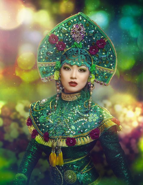 """Mila Fashion Exclusive hand-made Fantasy costumes Rental – Long green sequin dress, long sleeves, skirt slit on one side, embellished hem line. Fully lined top. – Large traditional heavy embellished headdress """"Kokoshnik"""" with long tule ties at the back. – Embellished corseted belt, feather trim – 2 embroidered, embellished sleeve attachments, feather trim. The whole costume is heavily hand-embroidered, embellished with golden trims, lace, metal buckles, stones, rhinestones , pearls and more."""
