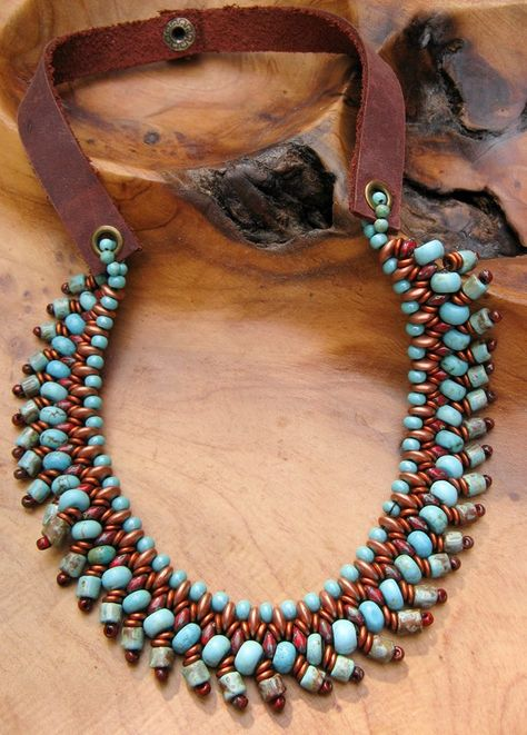 Beaded necklace in rich colors of turquoise, red, copper and gold using various size beads including super duos, lentils and O beads.  www.lindysdesigns.com